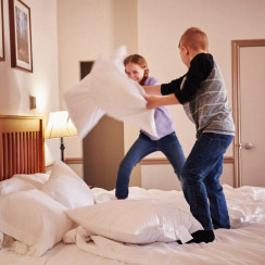 Children pillow fighting