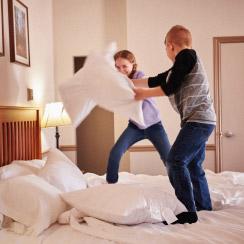 Children pillow fighting