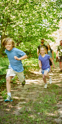 children running on a trail