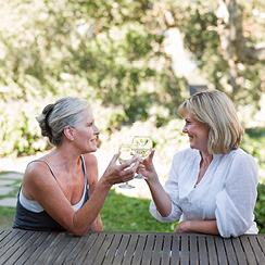 two women drinking wine in the garden