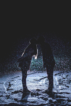 silhouette of couple kissing in the snow