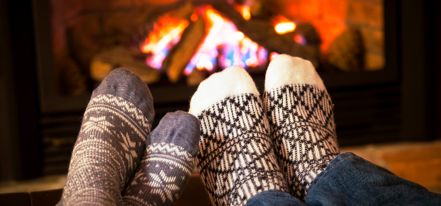 Photo of socks infront of a toasty fire