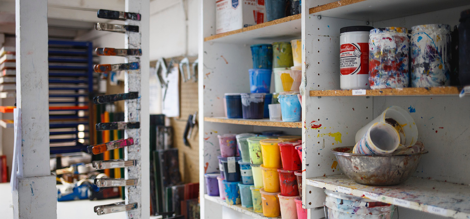 photo of a colourful and messy artist's studio