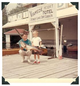 Photo from 1960s showing man and young boy with fish at Viamede Resort